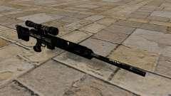 Rifle de francotirador en uniformes de camuflaje