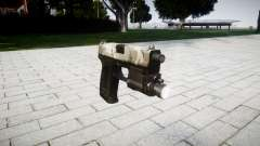 La pistola HK USP 45 woodland