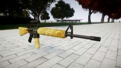 El rifle M16A2 [óptica] de oro